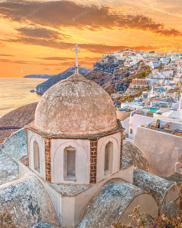 Sunset view and greek orthodox church in Fira village in greek island Santorini in Greece, Europe.