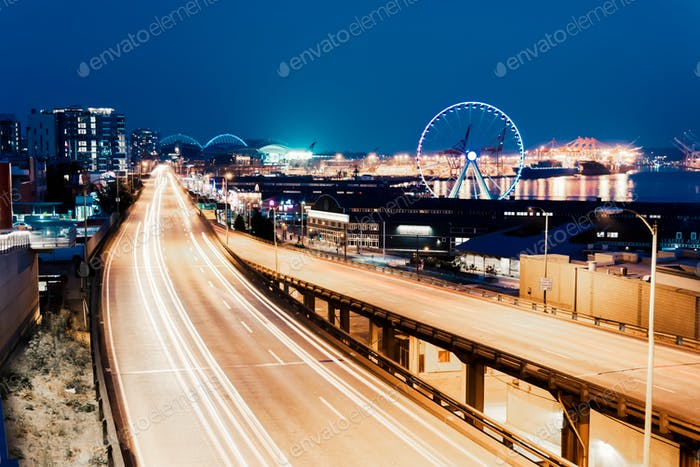 Long exposure of the Seattle Alaska way viaduct at night with light trails from traffic headlights