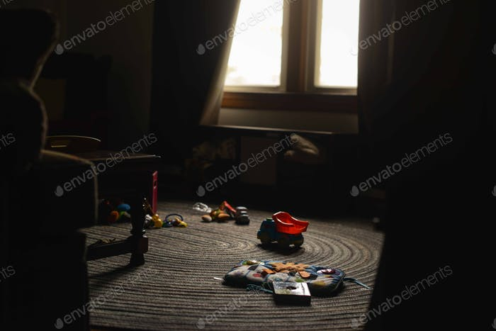 Real life photo of a messy living room with kids' toys everywhere