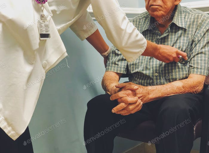 Man being checked by doctor