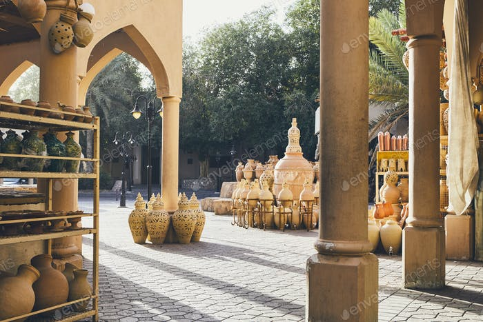 Ceramics for sale at traditional souk. Street of city Nizwa, Sultanate of Oman.