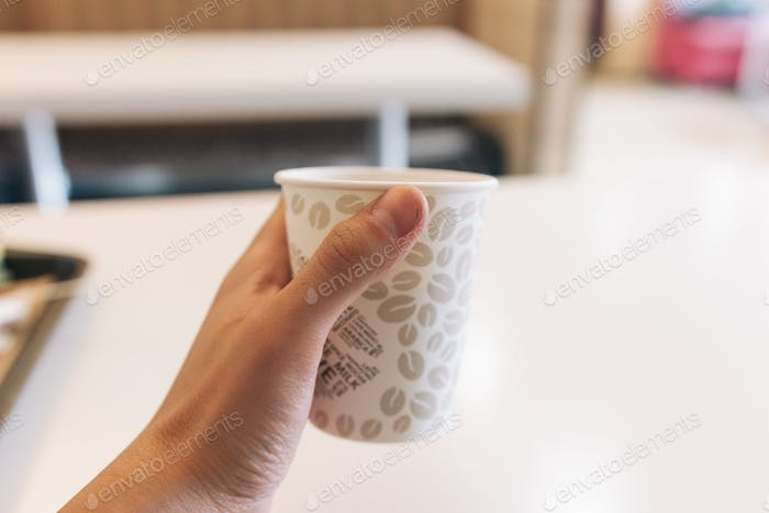 Paper cup in the hand