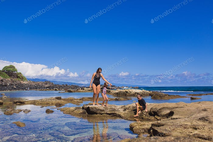 Mom and kids exploring tide pools