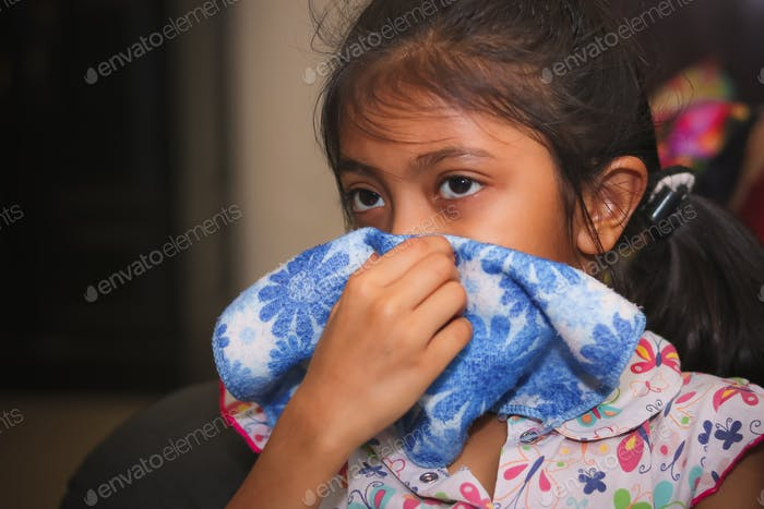 Little girl unwell with cold