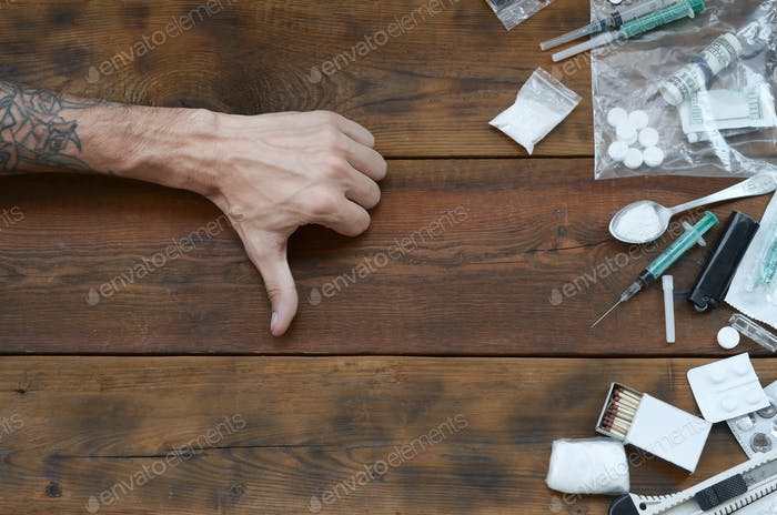 Male hands show dislike sign to all of narcotic stuff definitions
