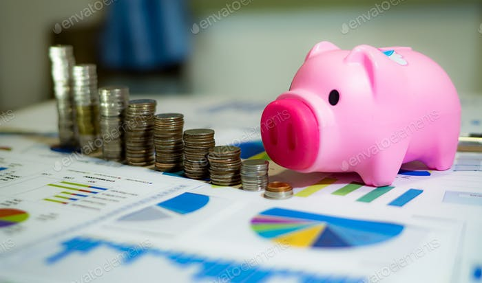 Digital Composite Image Of Businessman Covering Stacked Coins With Line and Grap piggy bank saving