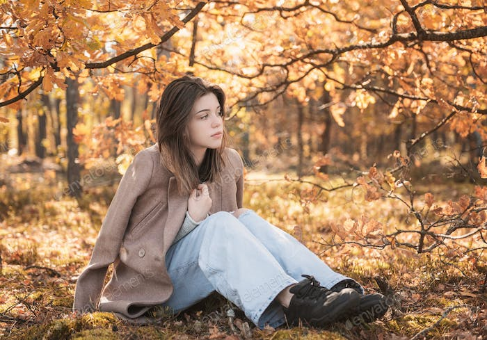 Portrait of a thoughtful and sad girl. Autumn colors . Lifestyle. Autumn mood. Forest