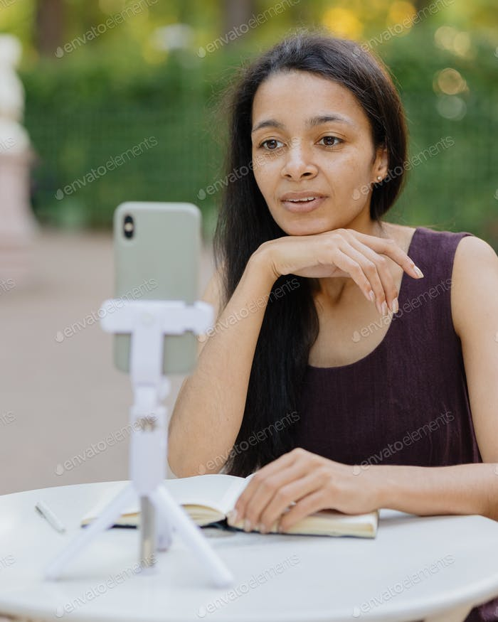 african woman young and beautiful making a video call