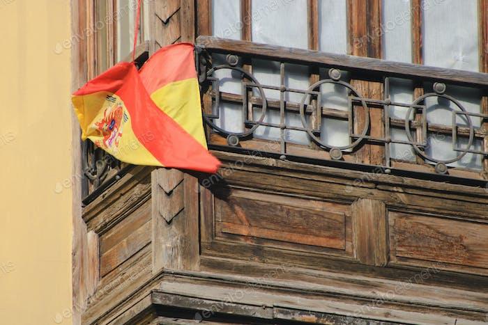 Spain's has flag on a balcony in Valencia, Spain