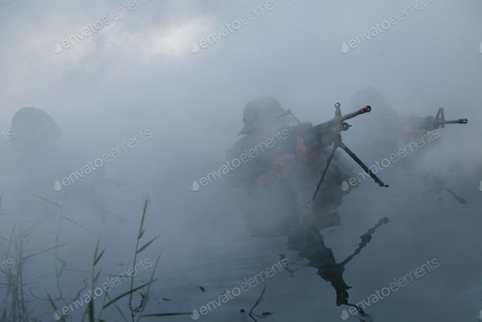 Thailand special forces soldiers with weapon.Bearded soldier in action during river raid
