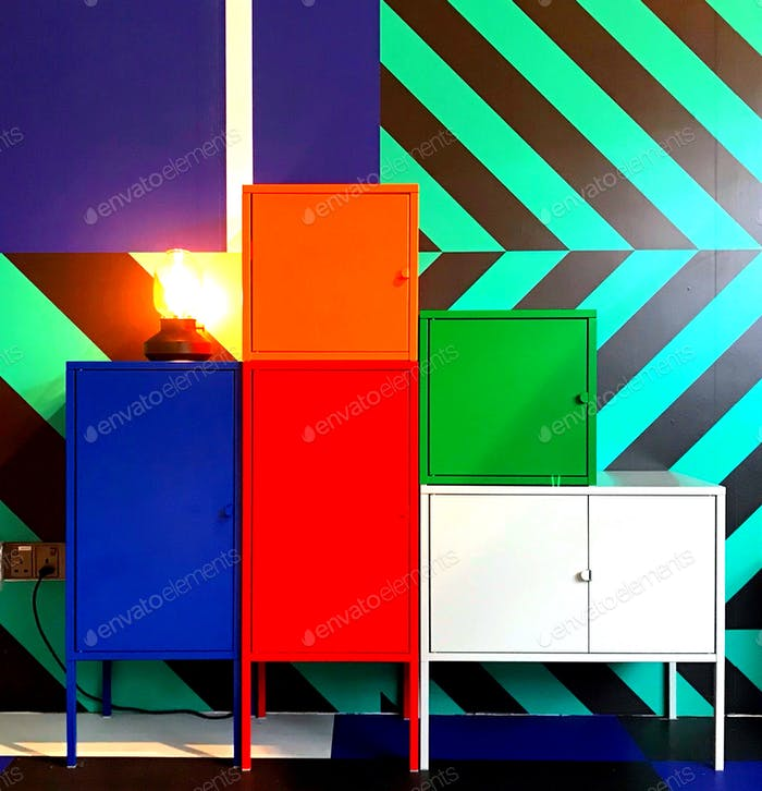 Colorful cabinets with a colorful backdrop