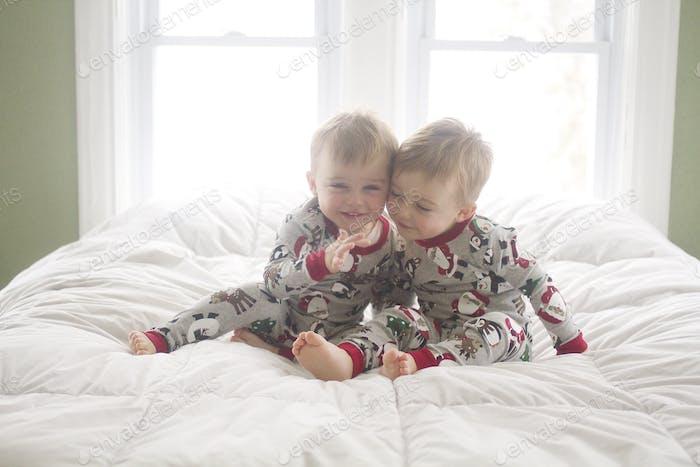 Christmas pajamas on bed children