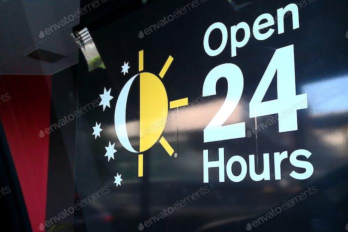 Open 24 hours sticker sign on glass window