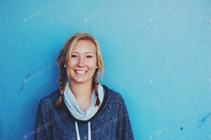 bold blonde with a blue background