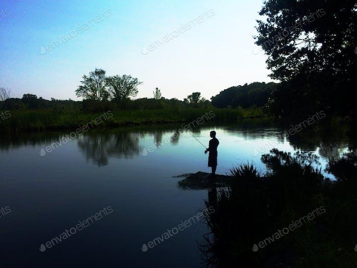 Fishing at sunset in the Adirondacks