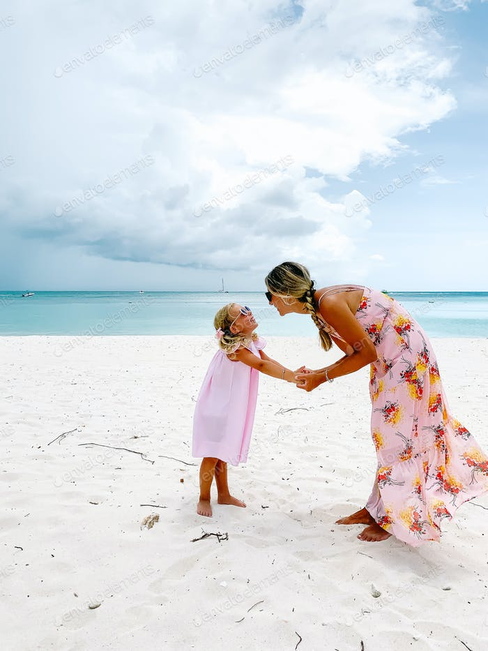 Mommy and daughter on a beach
