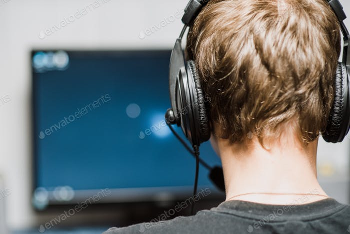 gamer headphones sitting room one back internet monitor