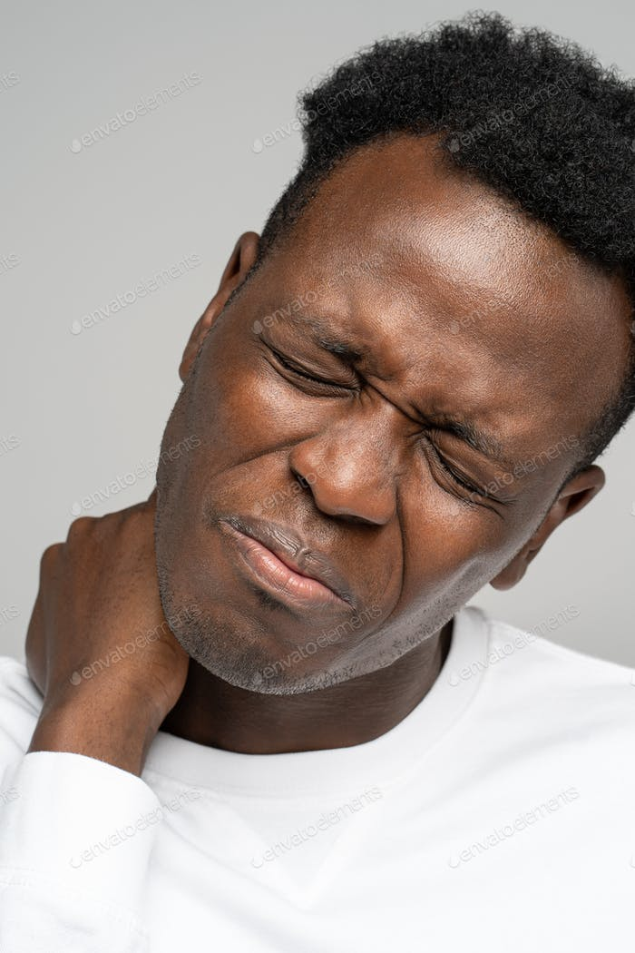 Black man holding hand on neck, closed eyes, suffers from pain and pinched nerve in forearm