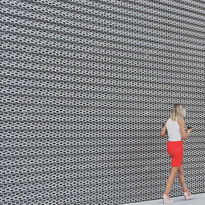 Stylish stroll.... Lady in red