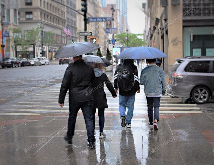 People in the city rainy day