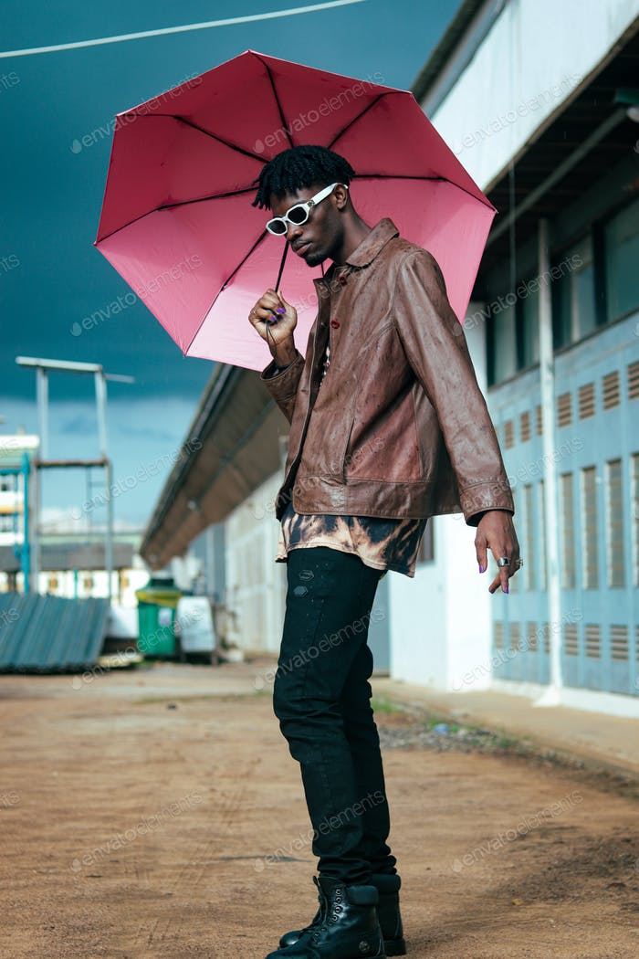 A male holding an umbrella