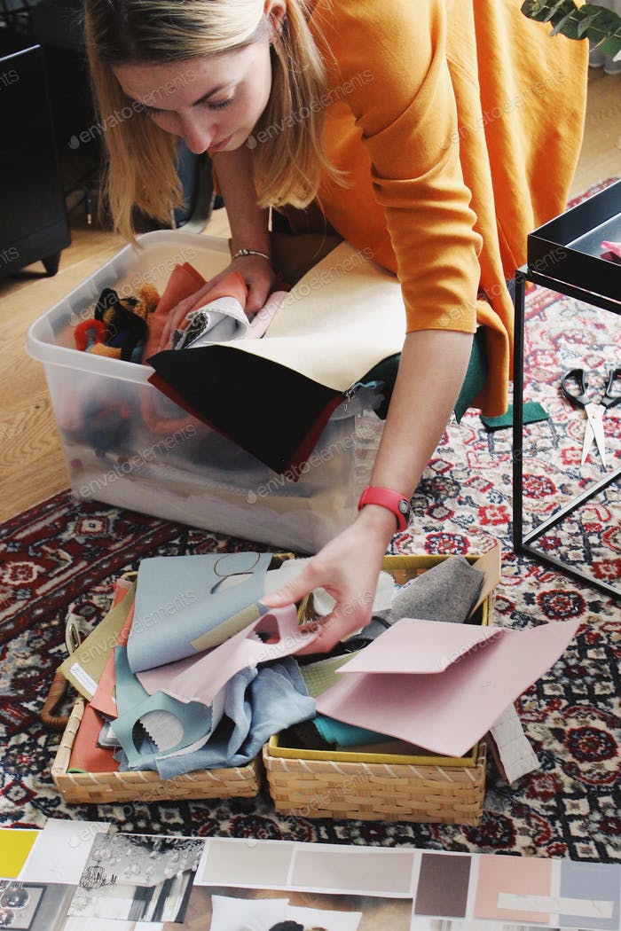 Girl taking colorful paper for crafting and mood board
