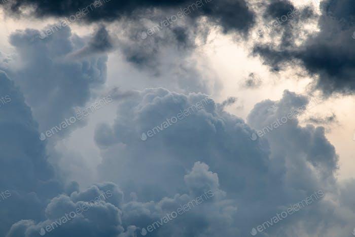 Blue sky. White cumulus clouds.