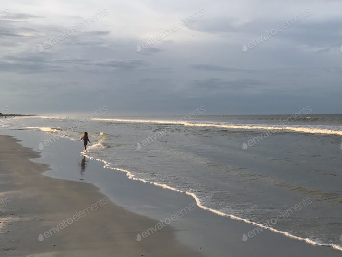 Walking on the shoreline. Florida living