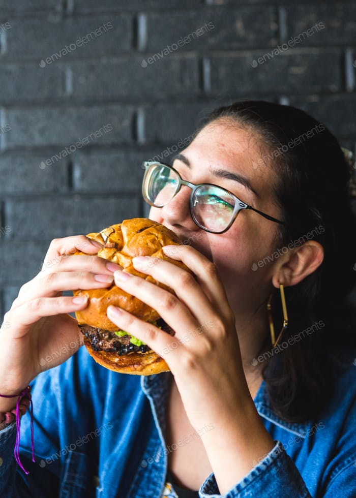 Girl Eating Burger