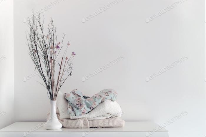 Neatly organized clothes on white background
