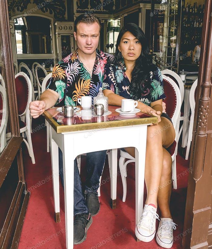 Fierce couple having coffee