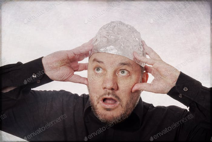 paranoid man with tin foil hat  - conspiracy theories