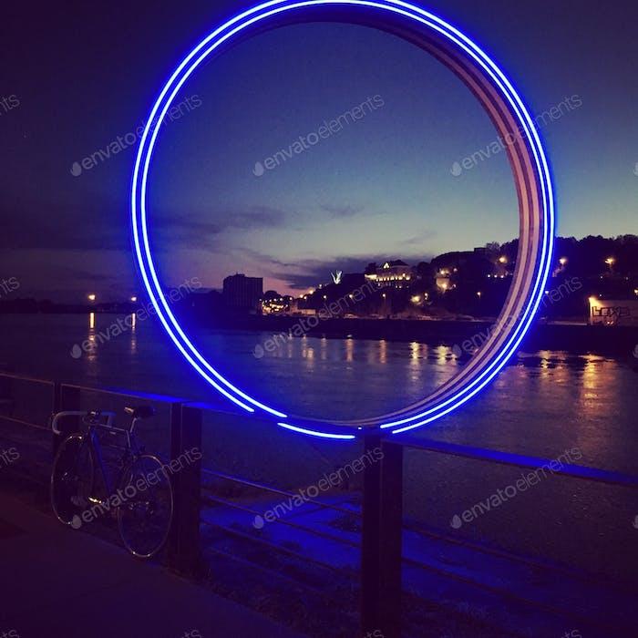 River in the night. Purple . Neon lights