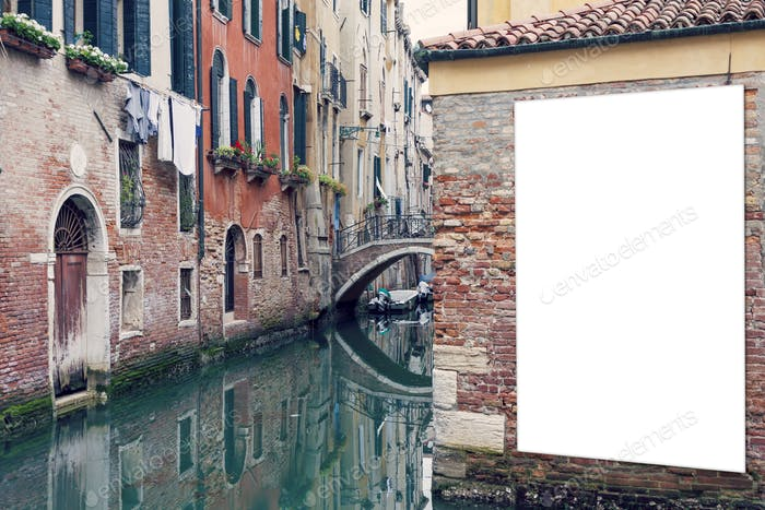 Blank vertically oriented outdoor billboard with copy space on the brick wall in Venice, Italy