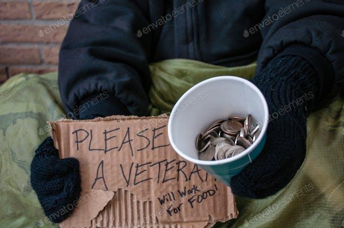 Homeless veteran begging for change