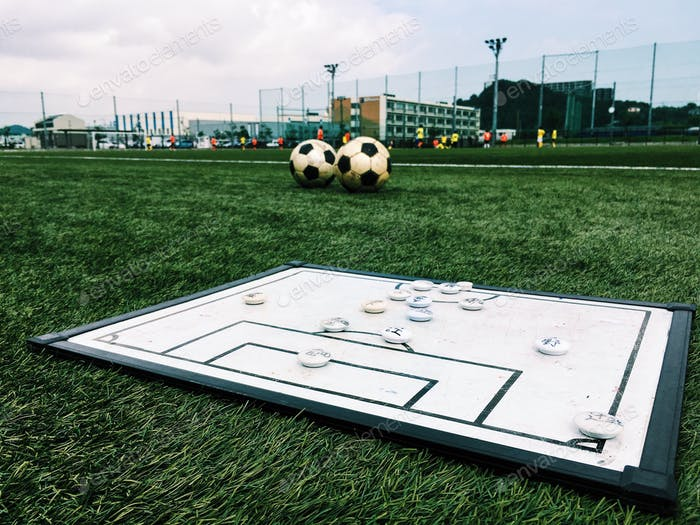Tactics board next to a football field.