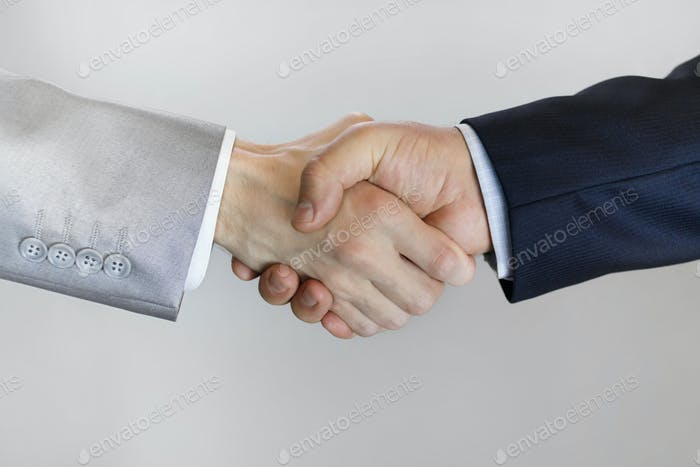 handshake of men in business suits close up