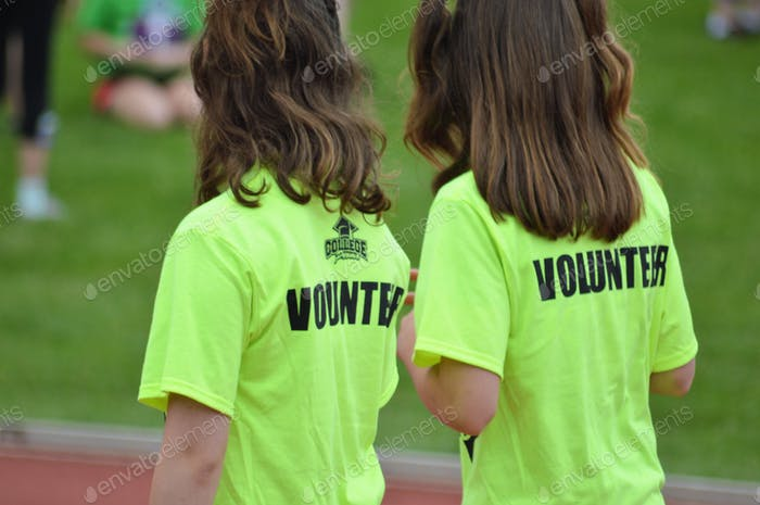 Volunteers!  People from behind. Twining. Teens. Twin Sisters. Volunteering. Volunteers.
