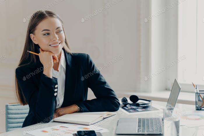Smiling business woman enjoying working day at office