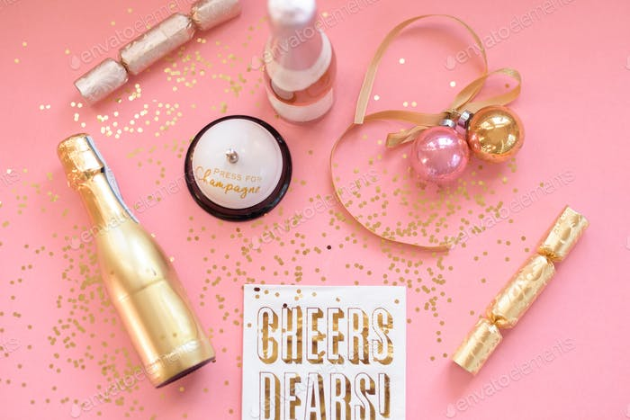 Pink and gold champagne flat lay