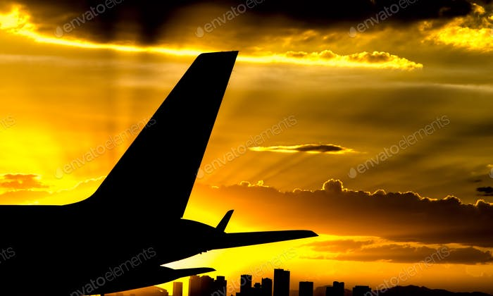 A B757 vertical fin silhouetted Buy a spectacular Phoenix sunset.