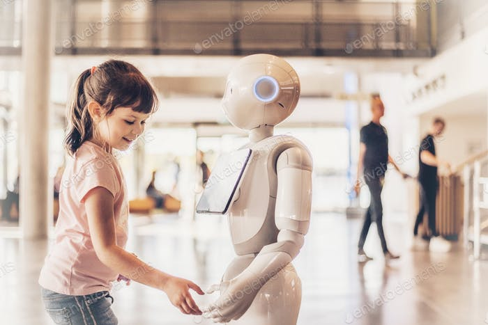 Girl interacting with a robot