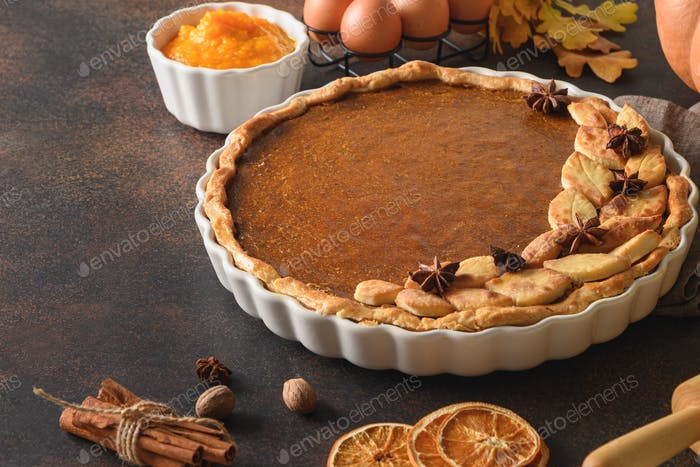 Homemade delicious tasty pumpkin pie with spices,cinnamon,cardamom, ginger for Thanksgiving Day