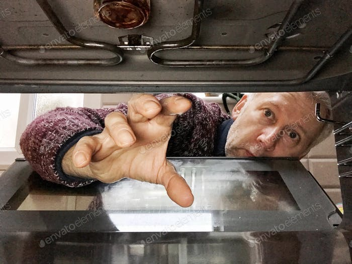 Cleaning the oven.
