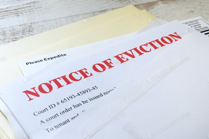 Side angle view of an official court ordered Eviction Notice in an envelope.