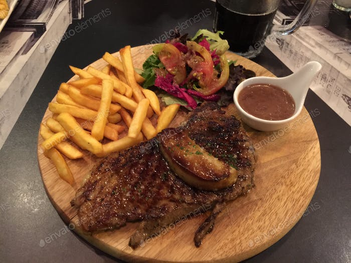 Beef steak top with foie gras