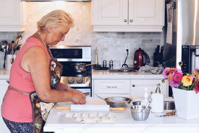 A woman is baking in a bright white modern kitchen.  Seniors lifestyle 💲 ✨NOMINATED✨