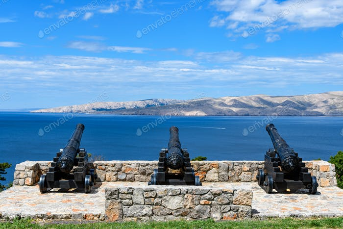 Medieval cannons aimed at sea. Weapons, naval, island, sea, view, warfare, museum, sighsteeing.