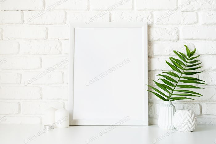 Poster template mock up with white vases and leaves on white brick wall background
