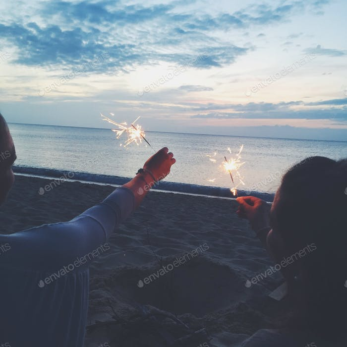 Sparklers at sunset on the beach